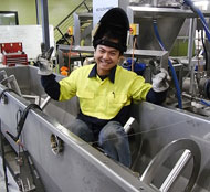 Gold Peg - Chau welding an Auger Feed Hopper